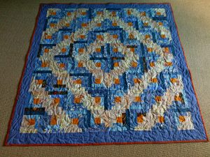 barn raising log cabin quilt in blue and ivory